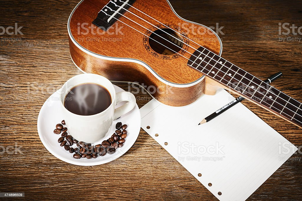 coffee and Ukulele with papernote royalty-free stock photo