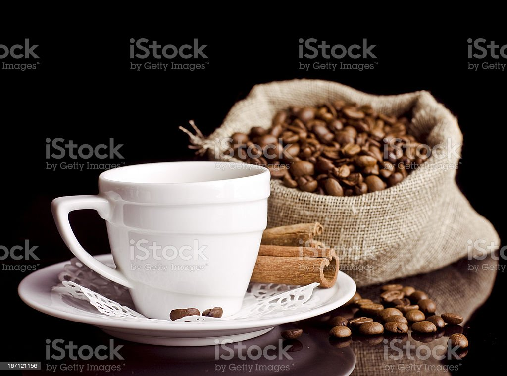 Coffee background and white cup isolated in black royalty-free stock photo