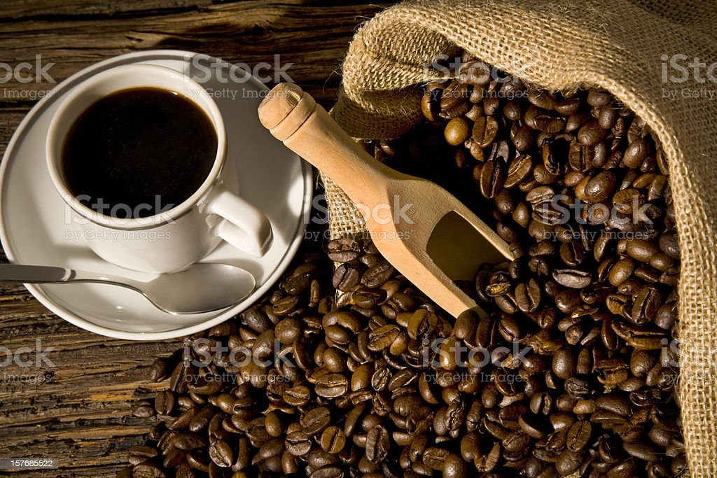 Coffee bean in a jute bag with wood ladle royalty-free stock photo