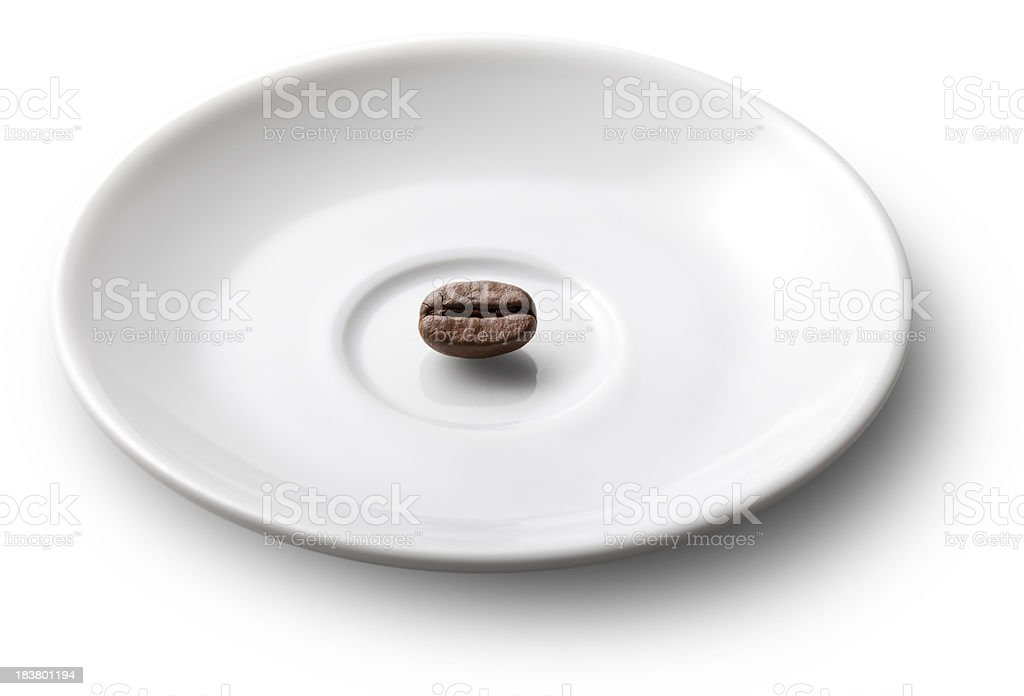 Coffee bean in a saucer stock photo