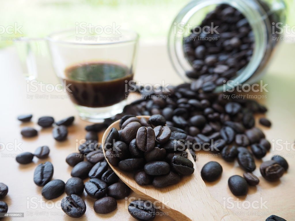 coffee bean with wood spoon stock photo