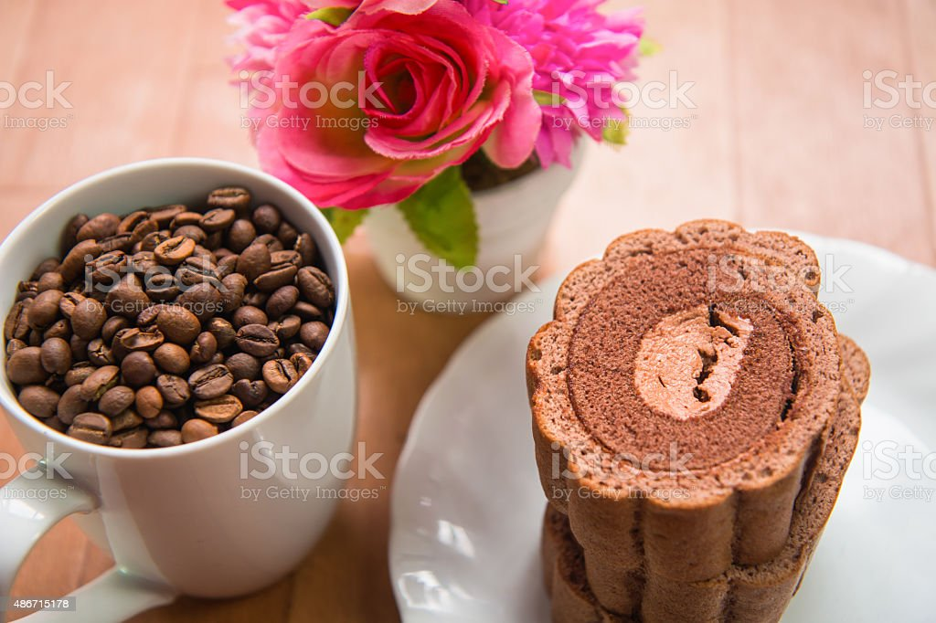 Coffee beans and Chocolate roll cake stock photo