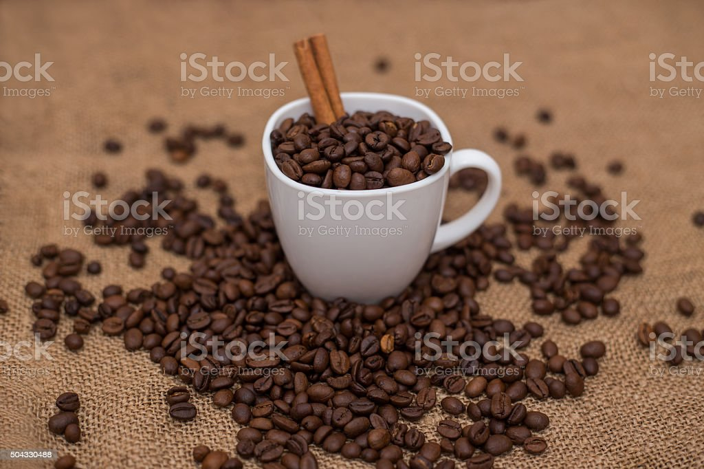 coffee beans and cinnamon white cup stock photo