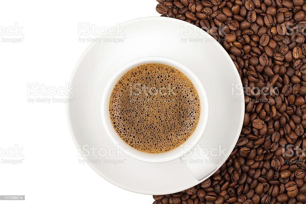 Coffee beans and cup background royalty-free stock photo