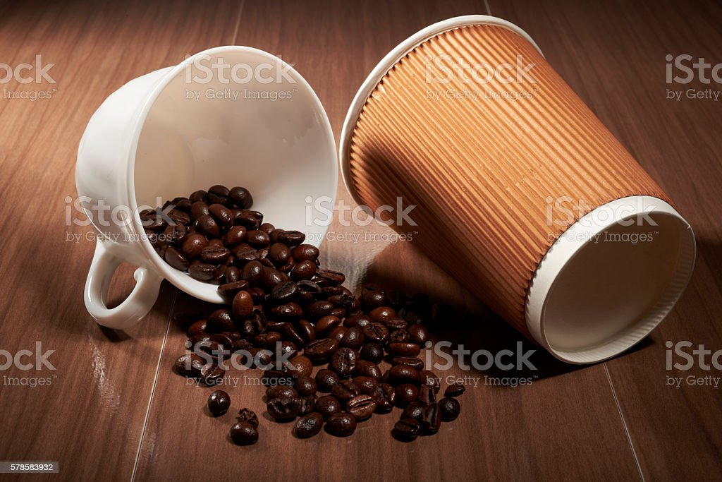coffee beans and cup upset stock photo