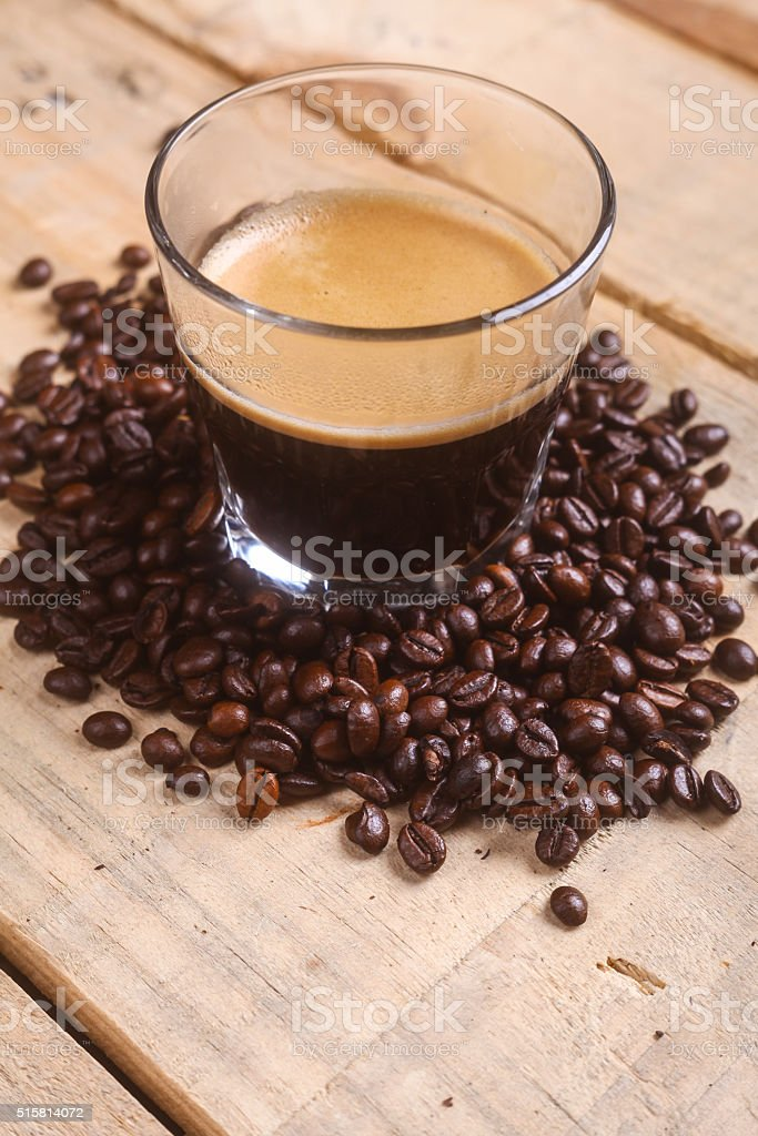 Coffee beans and fresh coffee stock photo