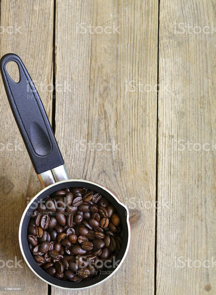 coffee beans and  pot on a wooden table royalty-free stock photo