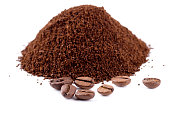 Coffee beans and powder on white background