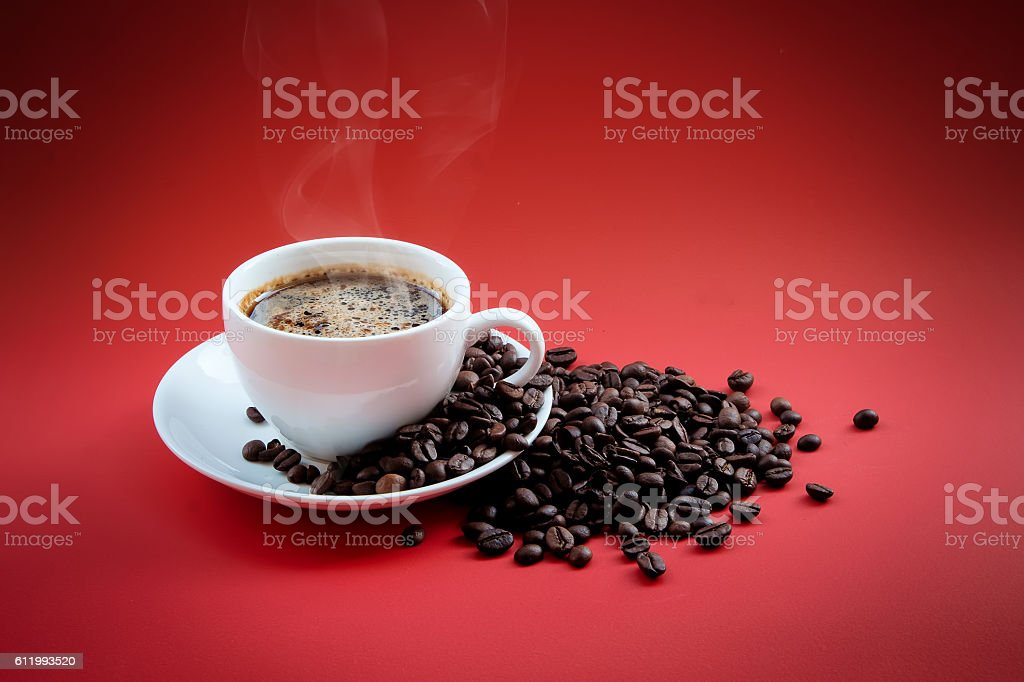 Coffee beans and red coffee cup stock photo