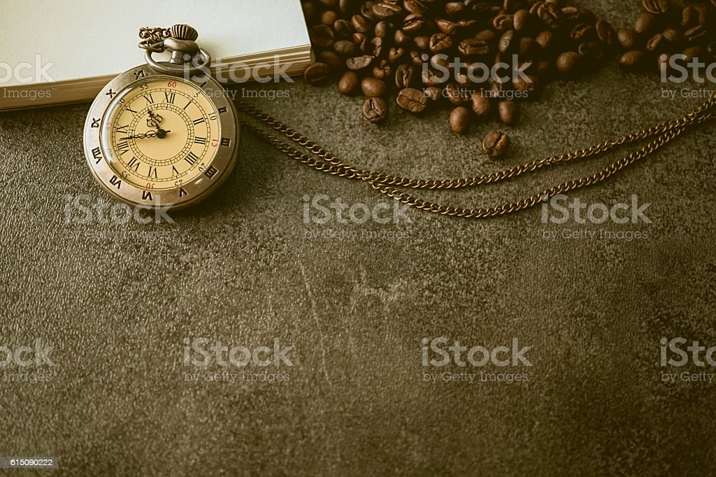 coffee beans and vintage pocket watch on dark vintage background stock photo