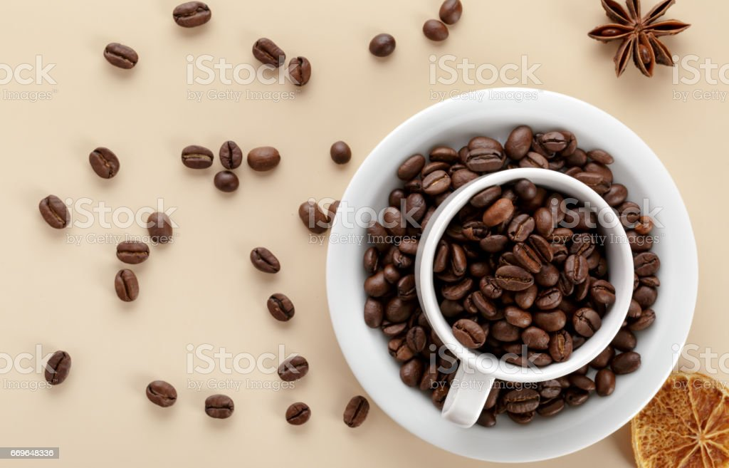Coffee beans and white cup of coffee stock photo
