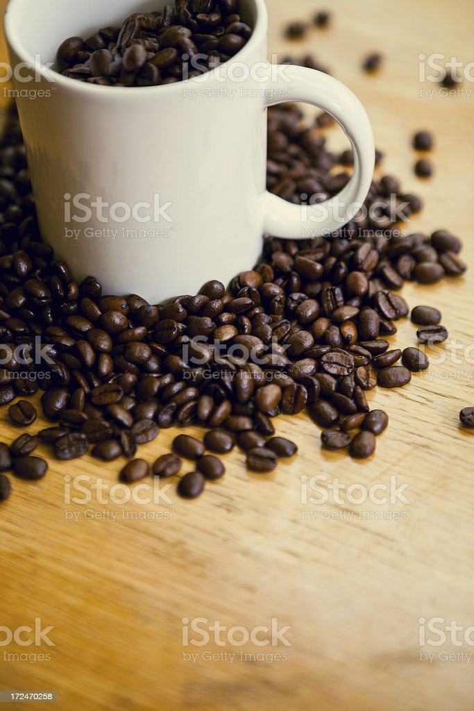 Coffee Beans and White Mug on Rustic Wood Surface royalty-free stock photo