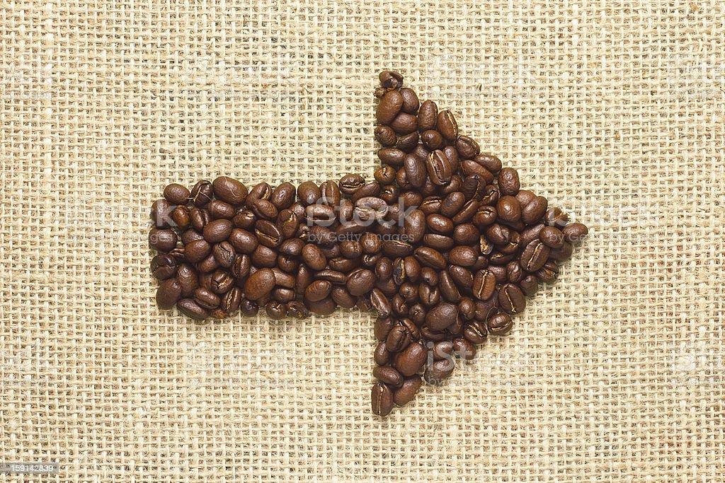 Coffee beans arrow on sacking royalty-free stock photo