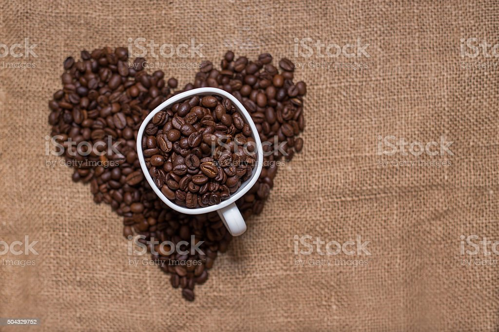 coffee beans burlap fabric stock photo