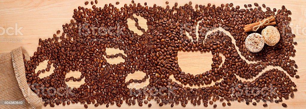 coffee beans, cinnamon and macaroons stock photo