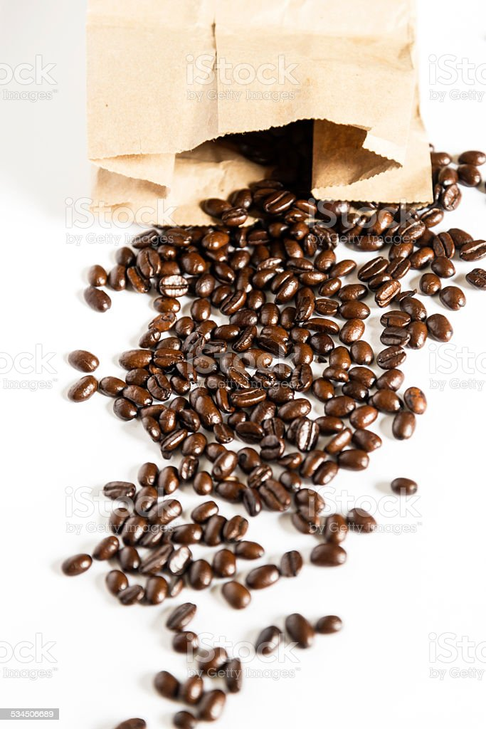 Coffee Beans Coming From Bag stock photo