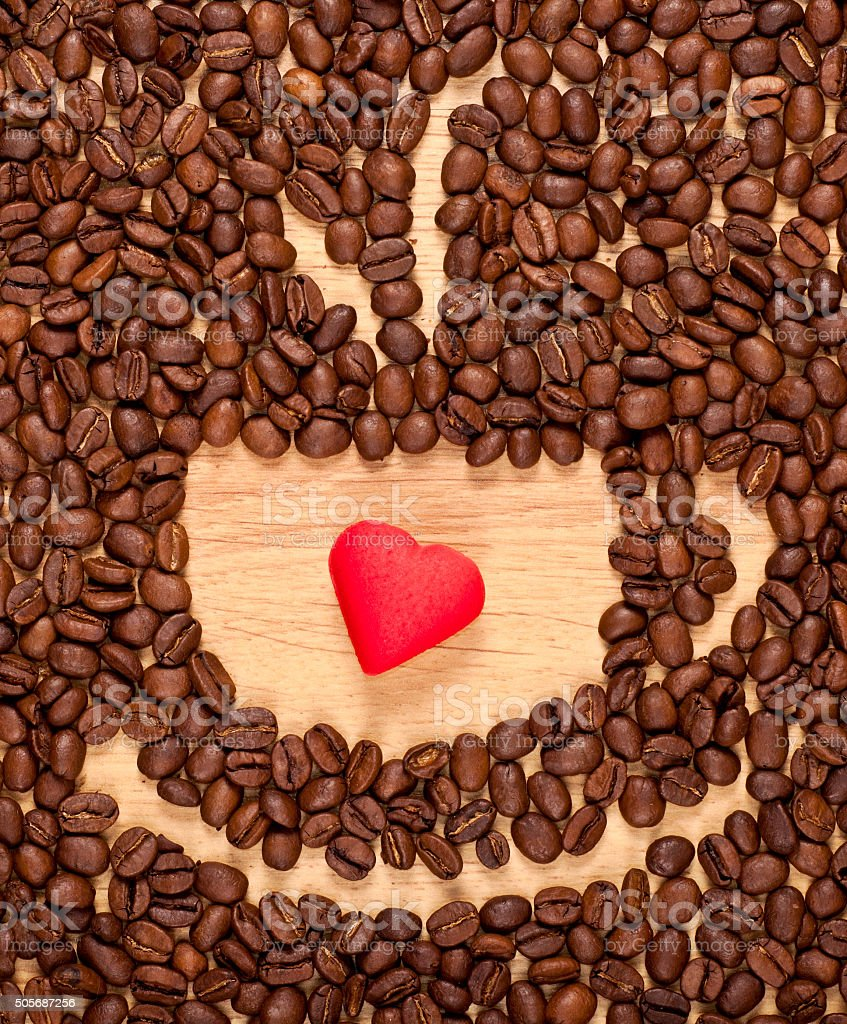 coffee beans cup and red heart stock photo