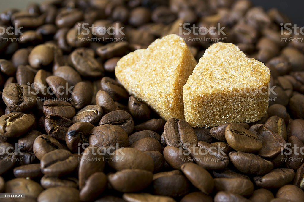 coffee beans, cup, Pots, cinnamon on dark background royalty-free stock photo