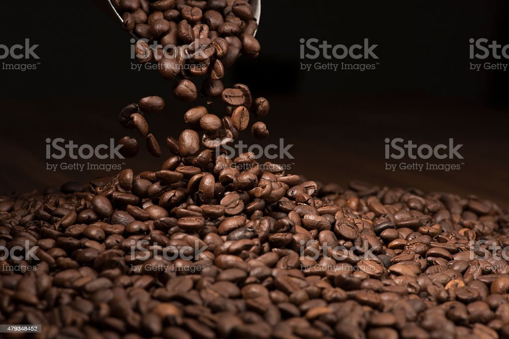 Coffee Beans Falling Into Bag stock photo