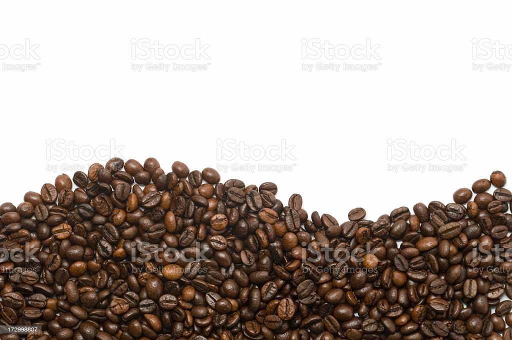Coffee beans forming a wave over a white background royalty-free stock photo