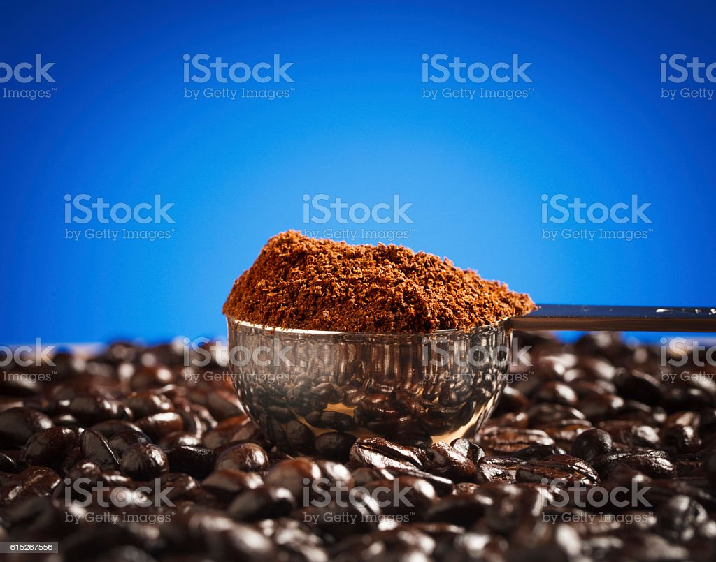 Coffee Beans & Grounds on Blue Background stock photo