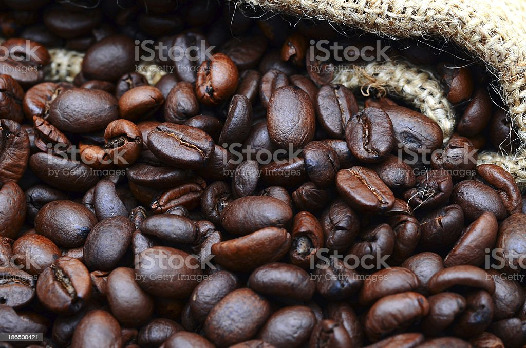 Coffee beans in a bag on sacking. royalty-free stock photo