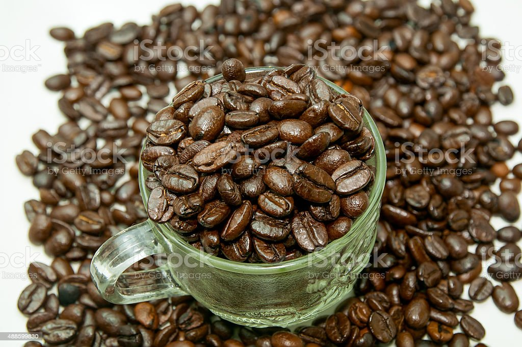 Coffee beans in a glass cup stock photo