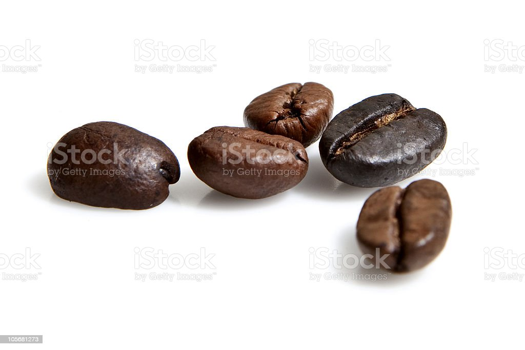 Coffee beans in a group isolated on white royalty-free stock photo
