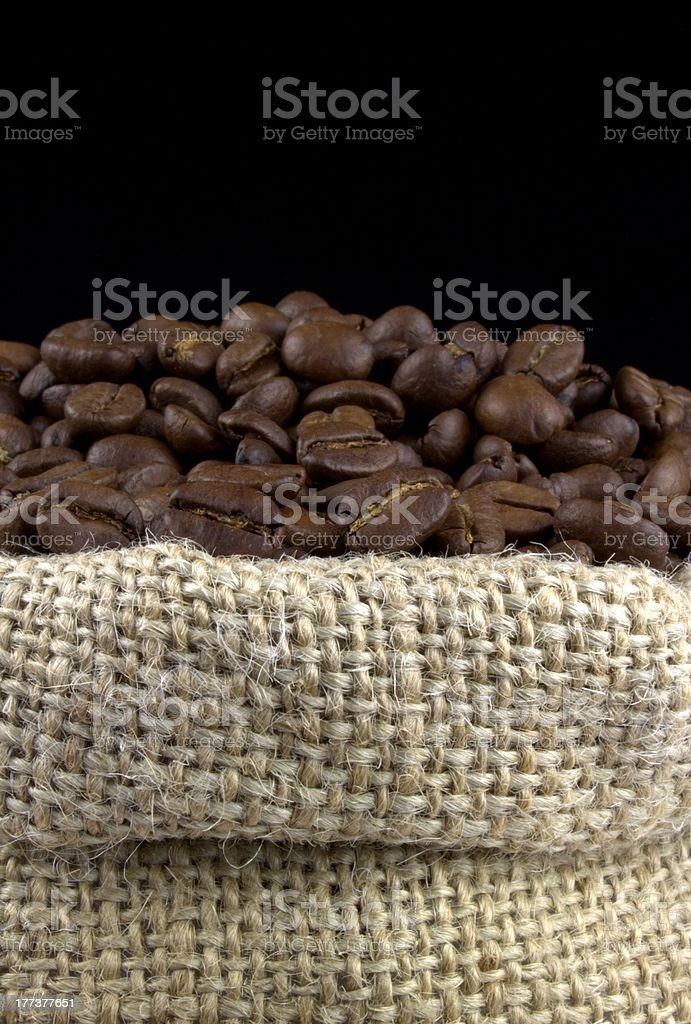Coffee beans in a linen sack royalty-free stock photo