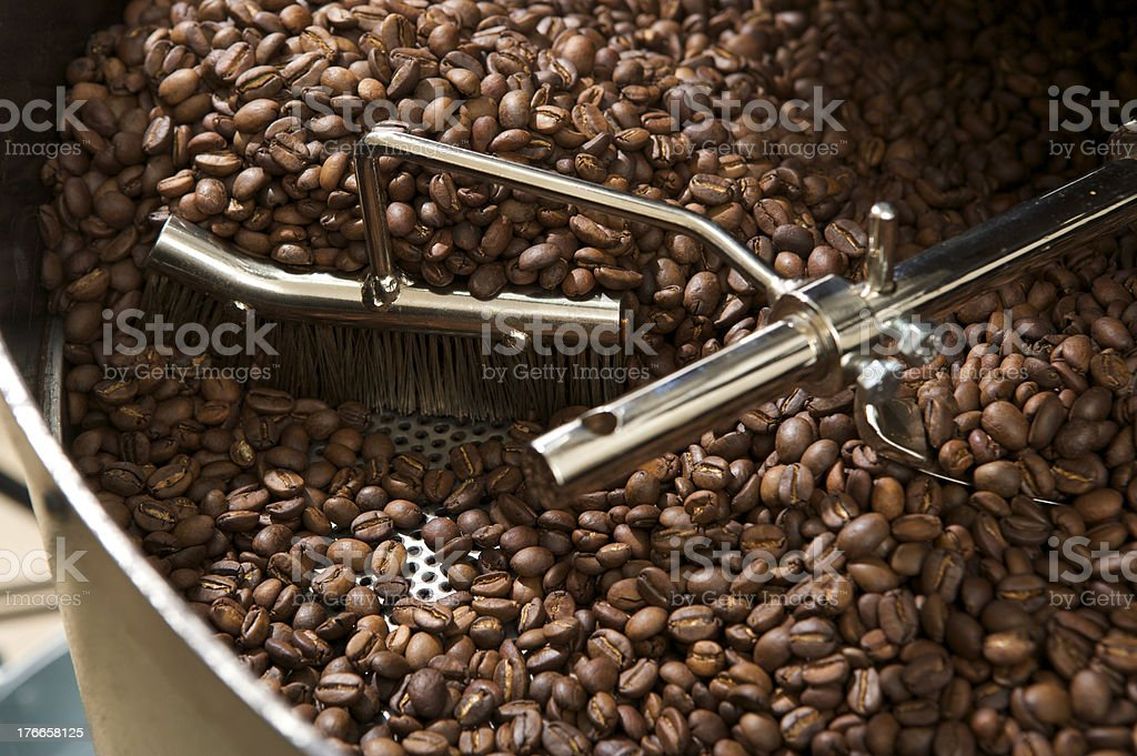 coffee beans in a roaster stock photo