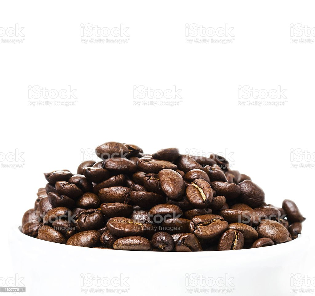 Coffee  beans in a white cup with copyspace for text. royalty-free stock photo