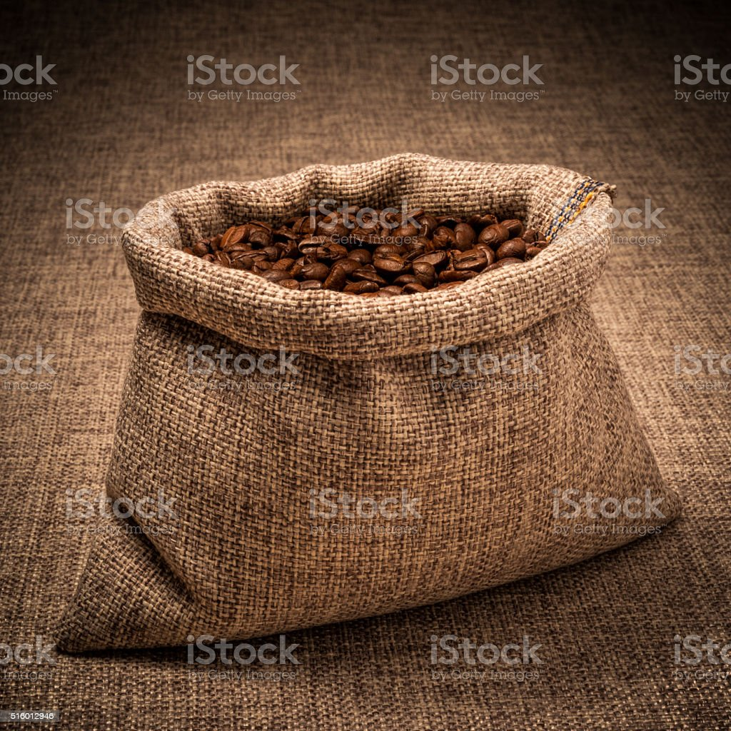 Coffee Beans in an Opened Canvas Sack stock photo