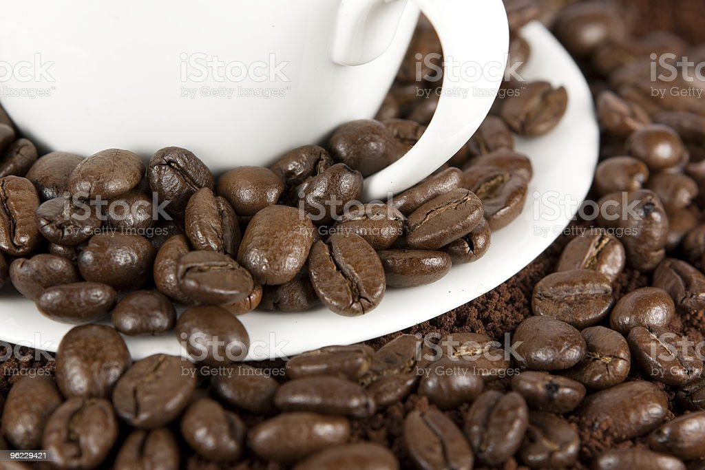 Coffee Beans in and Around a Cup stock photo