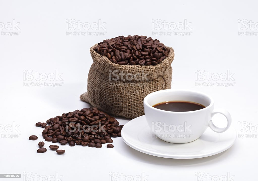 Coffee beans in bag and cup of coffee isolated on white stock photo