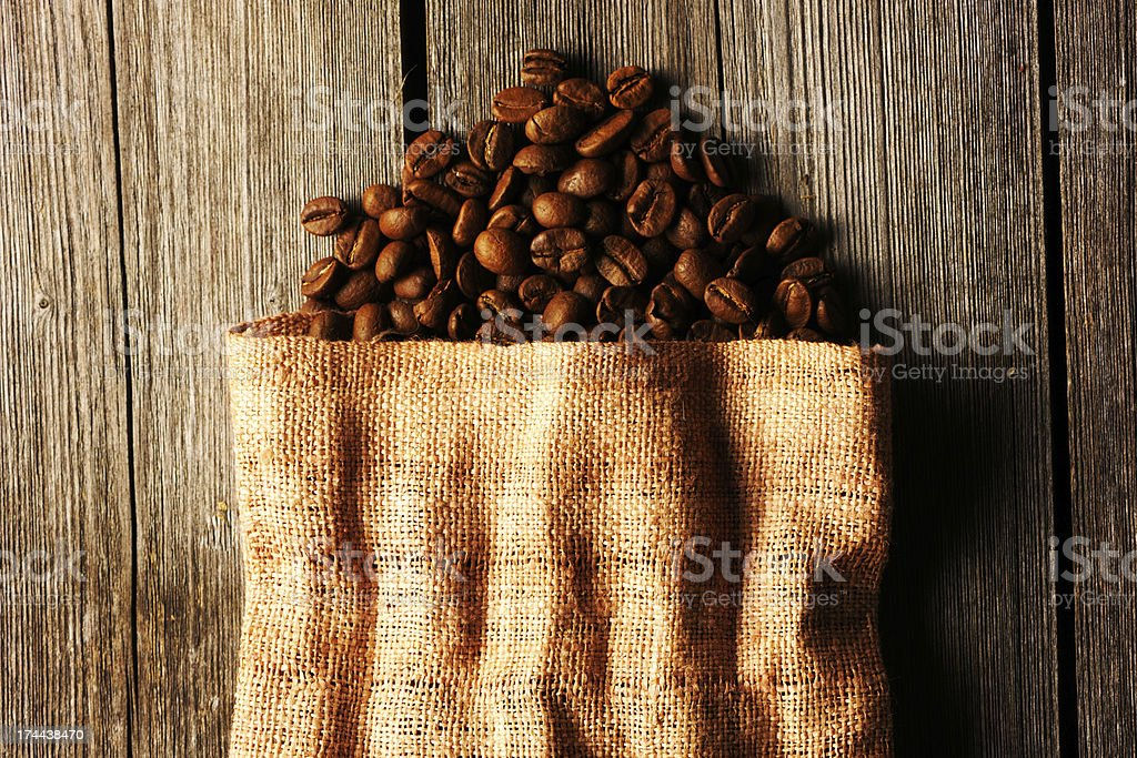 Coffee beans in bag background royalty-free stock photo