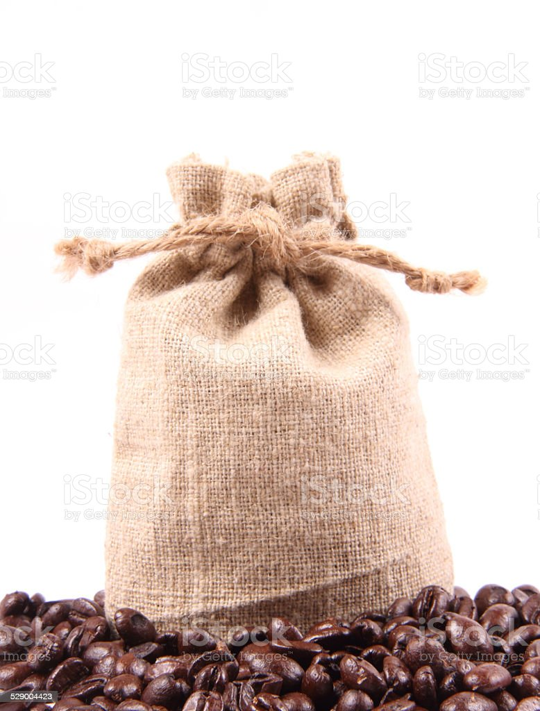 Coffee beans in bag isolated on white background stock photo