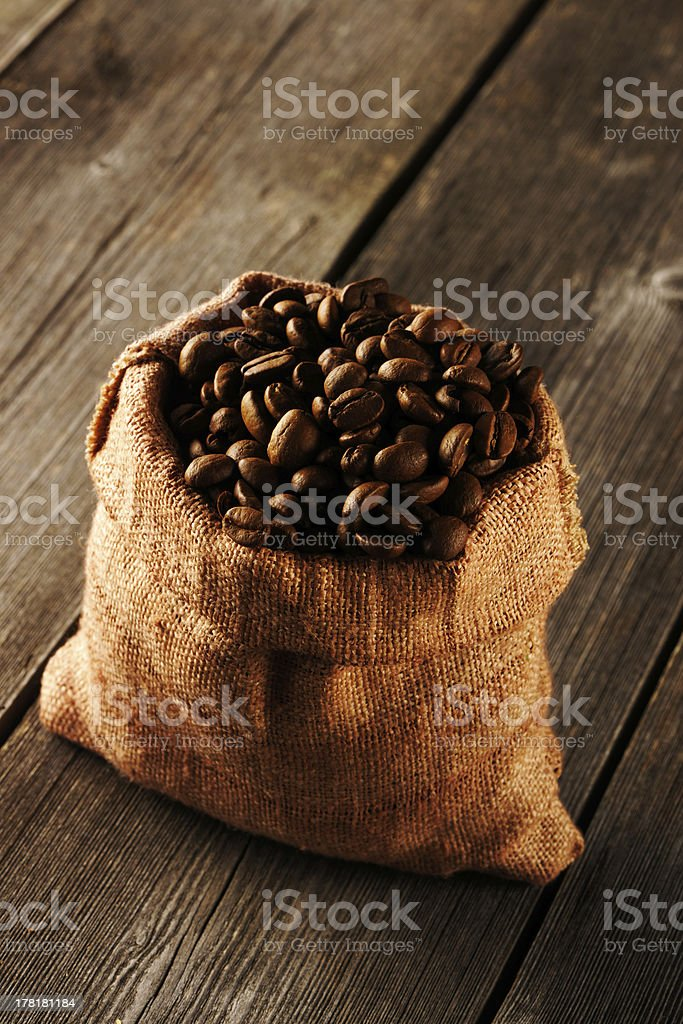Coffee beans in bag on table royalty-free stock photo