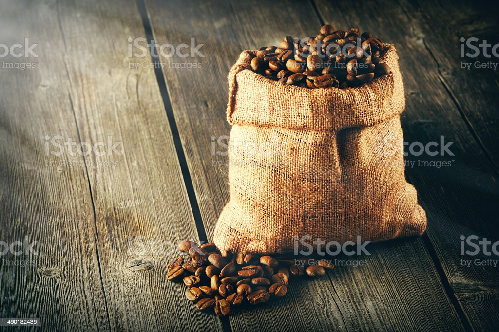 Coffee beans in bag on table stock photo
