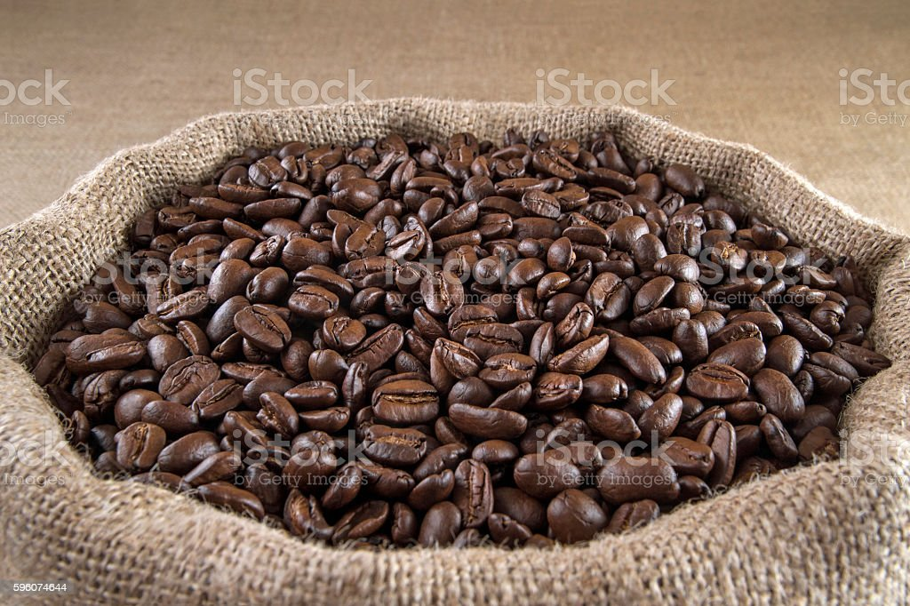 Coffee Beans in Burlap Sack stock photo