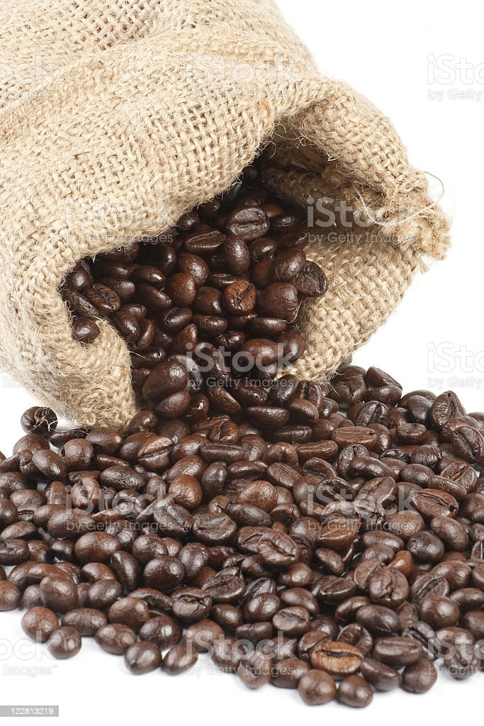 Coffee beans in canvas sack on white background stock photo