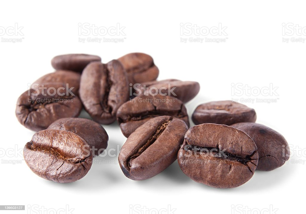 Coffee beans in closeup isolated on white stock photo