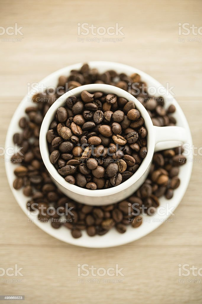 Coffee beans in coffee cup royalty-free stock photo
