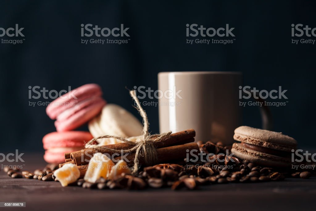 Coffee beans in cup on wooden background stock photo