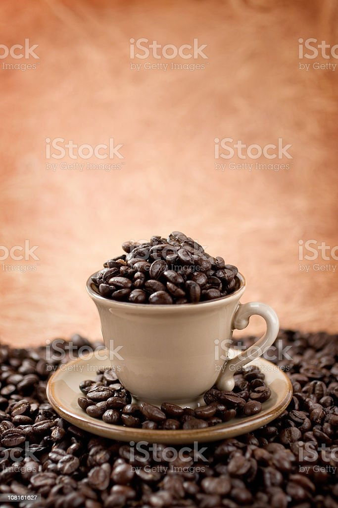 Coffee beans in espresso cup royalty-free stock photo