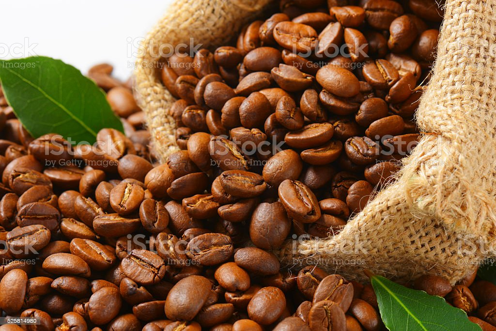Coffee beans in Hessian sack stock photo