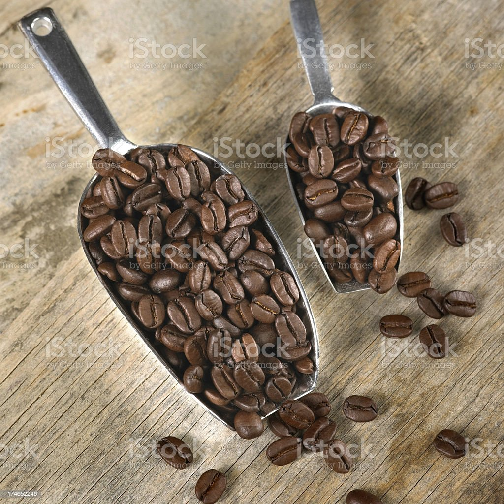 Coffee beans in scoops royalty-free stock photo