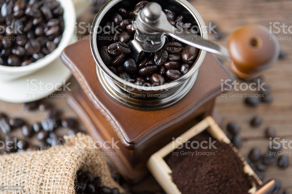 coffee beans in the bag and grinder. stock photo