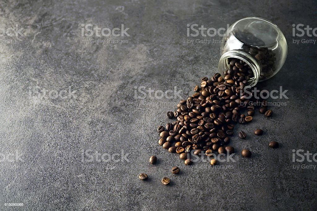 coffee beans in the glass jar on dark vintage background stock photo
