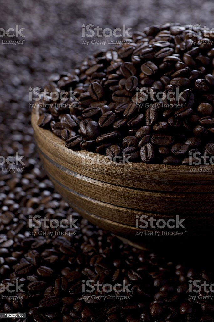 Coffee beans in the wooden cup royalty-free stock photo