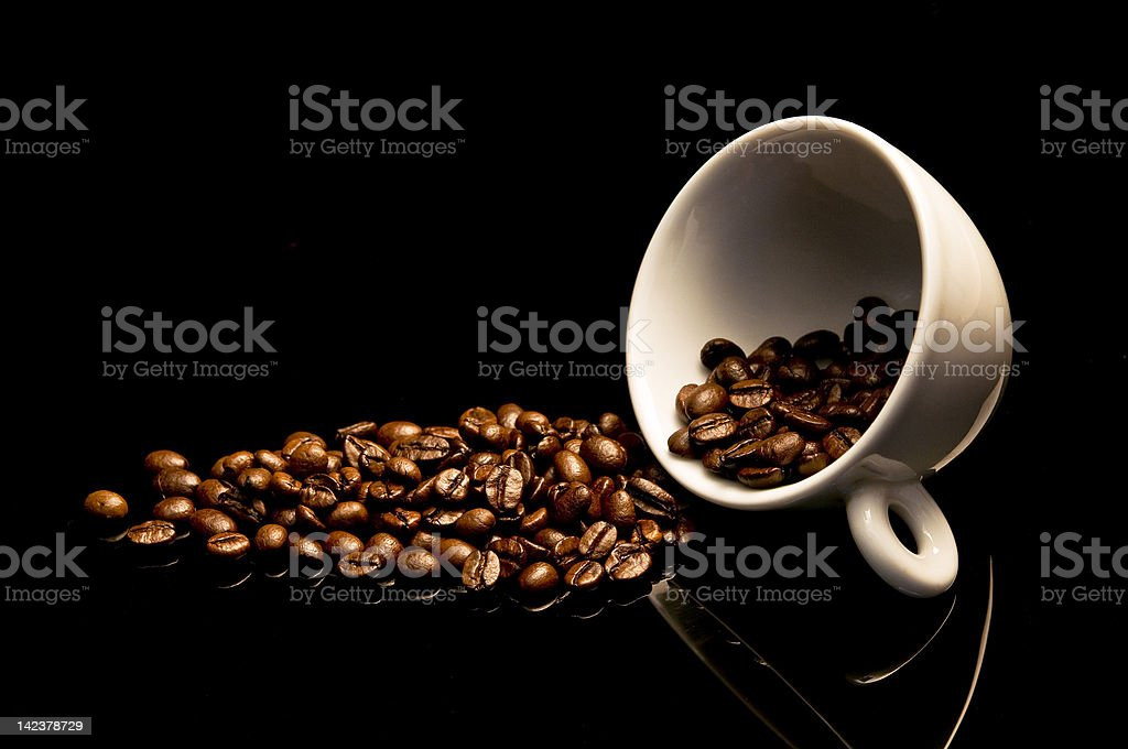 Coffee beans in white cup royalty-free stock photo